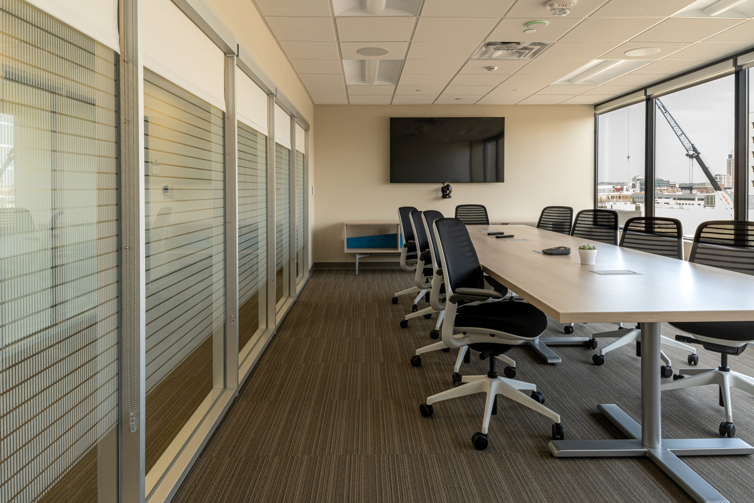 Conference table with chairs in a bright space.